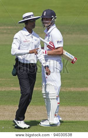 LONDON, ENGLAND - July 18 2013: Jonathan Trott stares at umpire Kumar Dharmasena on day one of the Investec Ashes 2nd test match, at Lords Cricket Ground on July 18, 2013 in London, England.