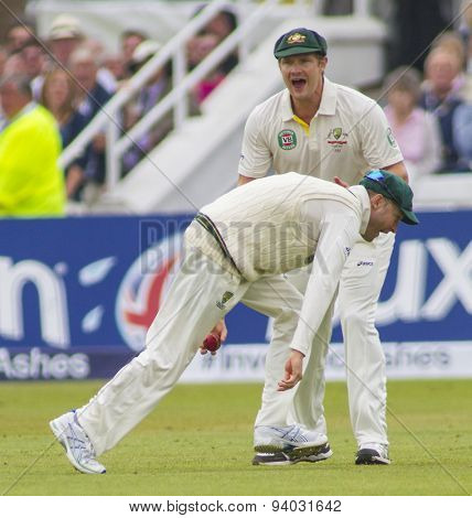 NOTTINGHAM, ENGLAND - July 10, 2013: Australia's Michael Clarke and Shane Watson celebrate the wicket  of Kevin Pietersen during day one of the first Ashes Test match at Trent Bridge Cricket Ground