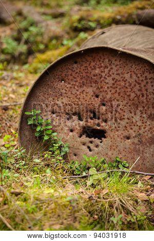 Rusty oil barrel in nature closeup