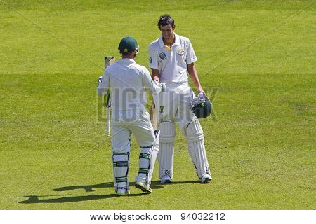 NOTTINGHAM, ENGLAND - July 11, 2013: Australia's Phillip Hughes congratulates Ashton Agar on his highest ever score during day two of the first Investec Ashes Test match at Trent Bridge Cricket Ground