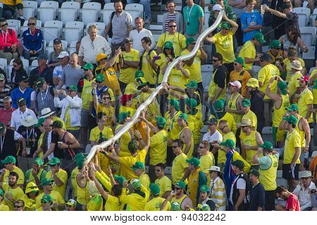 NOTTINGHAM, ENGLAND - July 11, 2013: The Fanatics create a beer glass snake during day two of the first Investec Ashes Test match at Trent Bridge Cricket Ground on July 11, 2013 in Nottingham, England