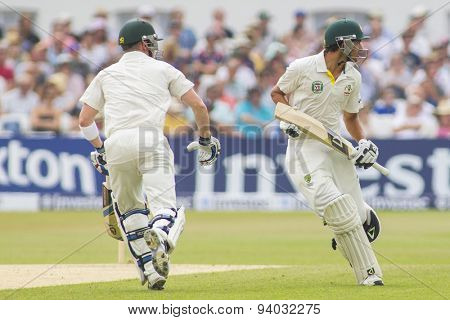 NOTTINGHAM, ENGLAND - July 14, 2013: Brad Haddin and Ashton Agar run a single during day five of the first Investec Ashes Test match at Trent Bridge Cricket Ground on July 14, 2013
