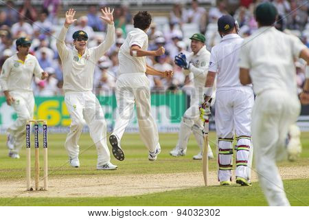 NOTTINGHAM, ENGLAND - July 12, 2013: Ashton Agar and Steven Smith celebrates the wicket of Jonny Bairstow during day three of the first Investec Ashes Test match at Trent Bridge Cricket Ground
