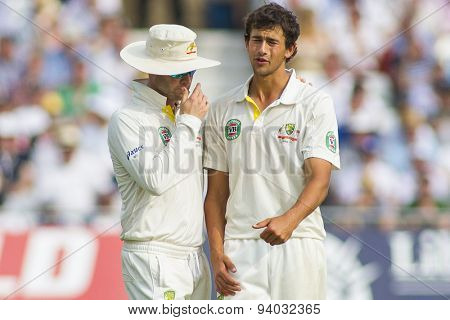 NOTTINGHAM, ENGLAND - July 12, 2013: Michael Clarke puts a hand on Ashton Agar's shoulder after he bowled a bad delivery during day three of the first Ashes Test match at Trent Bridge Cricket Ground