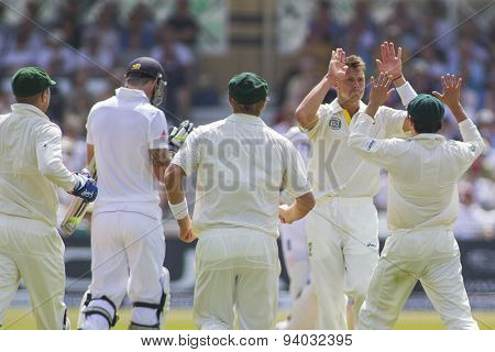 NOTTINGHAM, ENGLAND - July 12, 2013:Australia celebrates the wicket of Kevin Pietersen from the bowling of James Pattinson during day three of the first Ashes Test match at Trent Bridge Cricket Ground