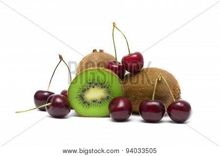 Ripe Cherry And Juicy Kiwi Closeup On A White Background