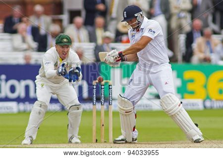 LONDON, ENGLAND - July 20 2013: Brad Haddin watches on as Tim Bresnan plays a shot during day three of the Investec Ashes 2nd test match, at Lords Cricket Ground on July 20, 2013 in London, England.