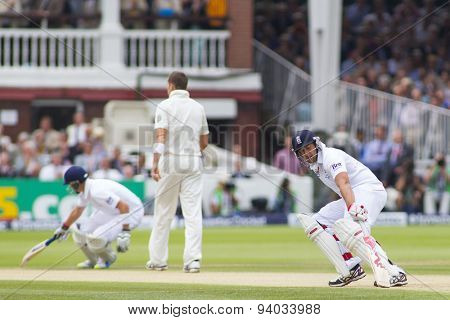 LONDON, ENGLAND - July 20 2013: Joe Root and Tim Bresnan run a single during day three of the Investec Ashes 2nd test match, at Lords Cricket Ground on July 20, 2013 in London, England.