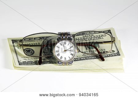 Stack Of Dollars, Watches And Glasses