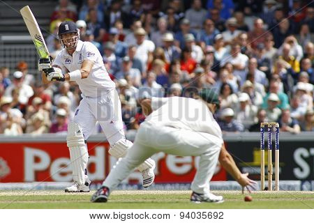 MANCHESTER, ENGLAND - August 03 2013: Kevin Pietersen hits the ball to Shane Watson during day three of  the Investec Ashes 3rd test match at Old Trafford Cricket Ground, on August 03, 2013