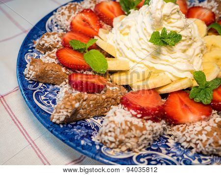 Chocolate Dessert With Banana And Strawberry Under Whipped Cream