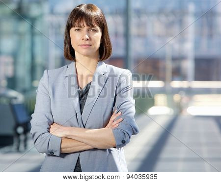 Serious Business Woman In Gray Suit Standing In The City