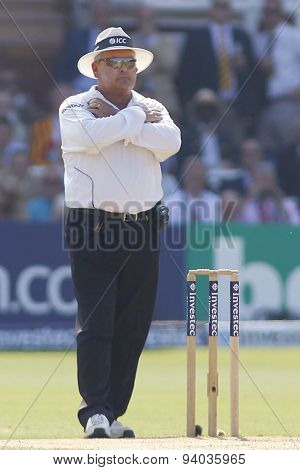 LONDON, ENGLAND - July 21 2013: Umpire Marais Erasmus signals he is reversing his decision after a DRS review during day four of the Investec Ashes 2nd test match, at Lords Cricket Ground
