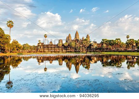 Cambodian landmark Angkor Wat with reflection in water on sunset. Siem Reap, Cambodia
