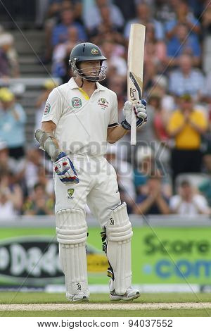 MANCHESTER, ENGLAND - August 01 2013: Chris Rogers raises his bat to acknowledge the crowd after scoring a half century during day one of  the Ashes 3rd test match at Old Trafford Cricket Ground