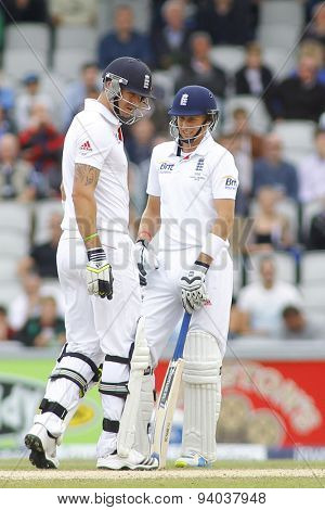MANCHESTER, ENGLAND - August 05 2013: Kevin Pietersen and Joe Root discuss an umpire's review during day five of  the Investec Ashes 4th test match at Old Trafford Cricket Ground, on August 05, 2013