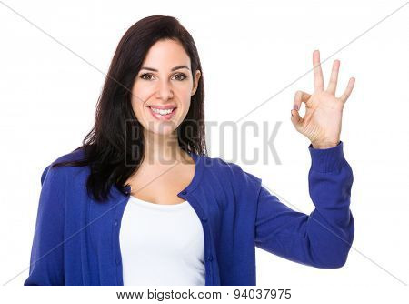 Brunette woman with ok sign gesture