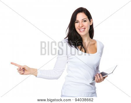 Brunette woman hold with digital tablet and finger point up