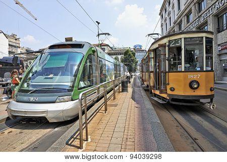 Milan Orange Cable Car And Modern Street Car