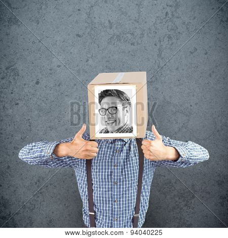 Businessman with photo box on head against dirty old wall background