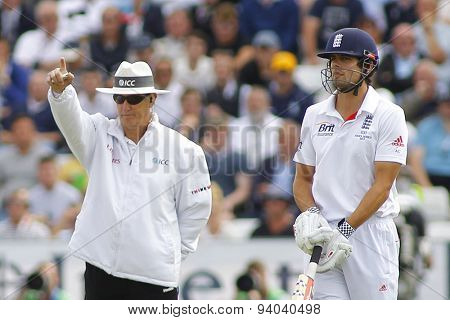 CHESTER LE STREET, ENGLAND - August 09 2013: Umpire Tony Hill signals out for Jonathan Trott as Alastair Cook looks on during day one of the Investec Ashes 4th test match