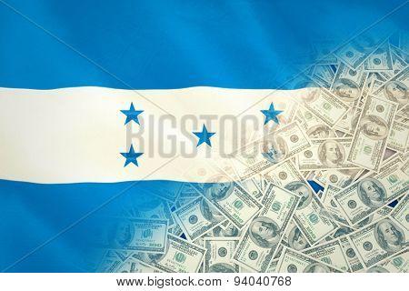 Pile of dollars against digitally generated honduras national flag
