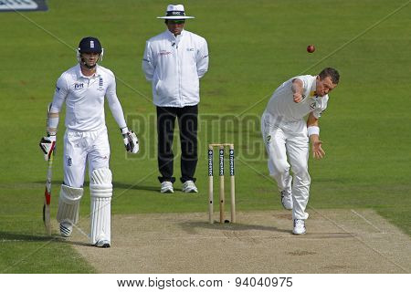 CHESTER LE STREET, ENGLAND - August 10 2013: James Anderson, Aleem Dar and Peter Siddle during day two of the Investec Ashes 4th test match at The Emirates Riverside Stadium, on August 10, 2013