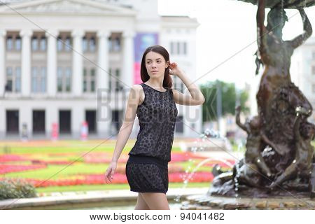 beautiful young woman walking in riga