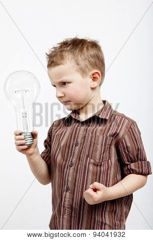 Boy holding huge bulb