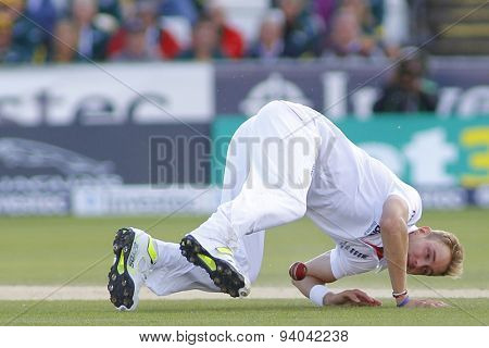 CHESTER LE STREET, ENGLAND - August 12 2013: Stuart Broad falls on the floor attempting to field the ball off his bowling during day four of the Investec Ashes 4th test match