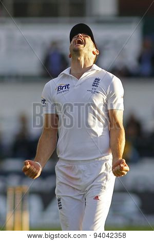 CHESTER LE STREET, ENGLAND - August 12 2013: James Anderson celebrates winning the match and winning the Ashes during day four of the Investec Ashes 4th test match at The Emirates Riverside Stadium