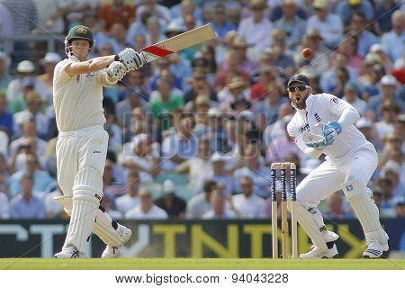 LONDON, ENGLAND - August 21 2013: Steven Smith plays a shot as Matt Prior watches on during day one of the 5th Investec Ashes cricket match between England and Australia