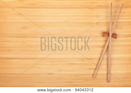 Sushi chopsticks on bamboo table with copy space