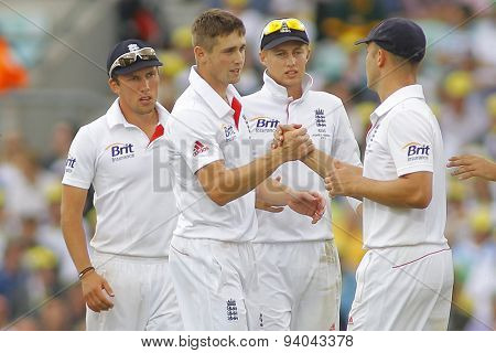 LONDON, ENGLAND - August 22 2013: Chris Woakes shakees hands with Jonathan Trott after Trott caught the ball during day two of the 5th Investec Ashes cricket match between England and Australia