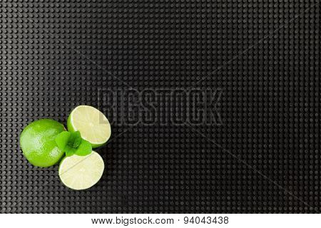 Lime and mint - mojito cocktail ingredients. Top view with copy space