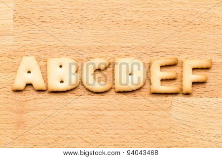 Letter ABCDEF cookie over the wooden background