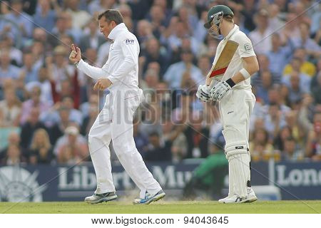 LONDON, ENGLAND - August 22 2013: Graeme Swann celebrates the wicket of Mitchell Starc as Steven Smith looks on during day two of the 5th Investec Ashes cricket match between England and Australia