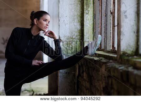 Beautiful Fitness Girl Stretching In Abandoned Building Before Workout