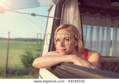 Beautiful woman sitting in a camper van