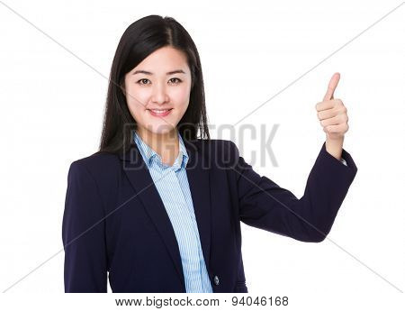 Young buisnesswoman with thumb up gesture