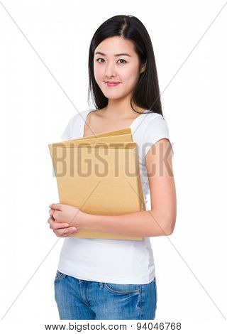 Student holding with her homework