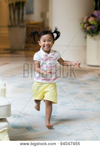 Asian little girl playing at home