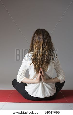 Woman In Reverse Namaste Pose During Meditation