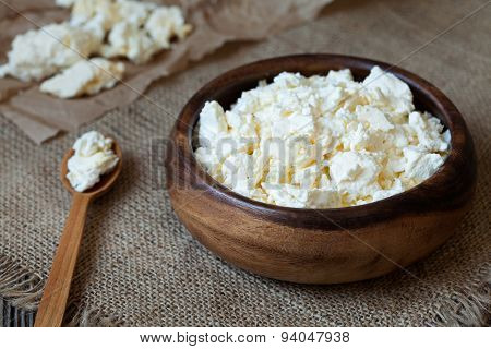 Traditional cottage cheese protein diary product, healthy breakfast in rustic wooden dish on vintage