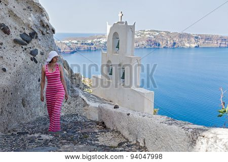 Woman Walks Up The Mountain Stairs. Greece Santorini