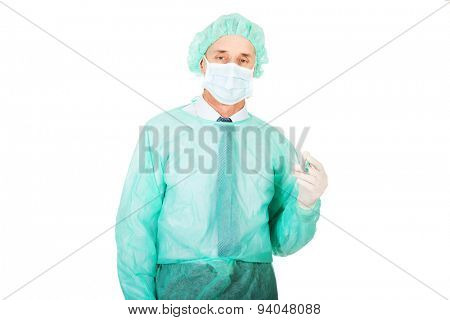Mature male doctor holding a syringe.
