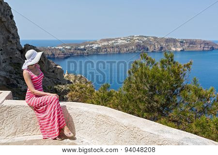 Woman Sits And Watches The Sea. Greece Santorini