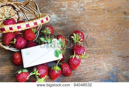Fresh red strawberries on old wooden background