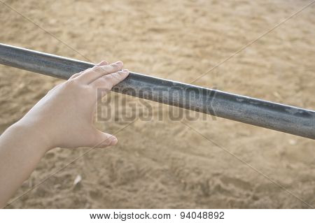 Left Hand Of Woman Touch Iron Tube