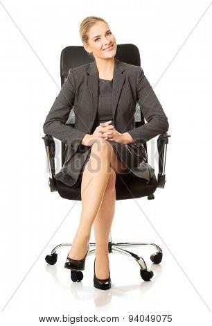 Beautiful businesswoman sitting on armchair